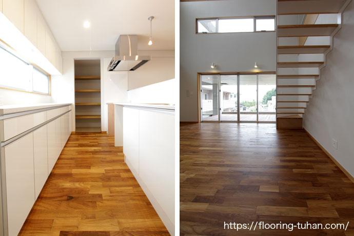 白基調のキッチンと、2階へと上がる階段にはチーク材を使用