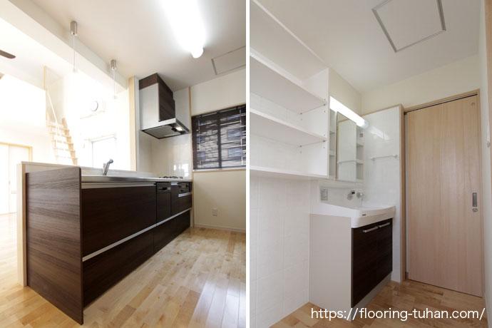 黒色で引き締めたキッチンと広い洗面所